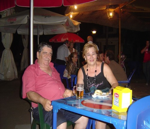 A happy couple enjoying the shrimp and cerveza