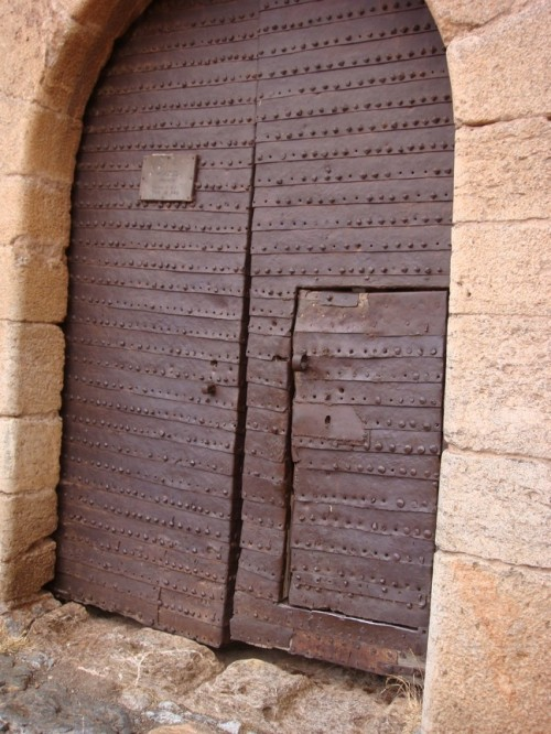 Fortress door. the sign says open on wednesdays only