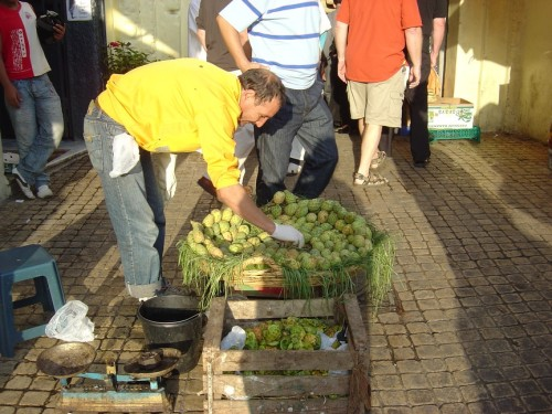 man selling prickly pairs